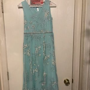 Long blue formal dress with gemstone and beads
